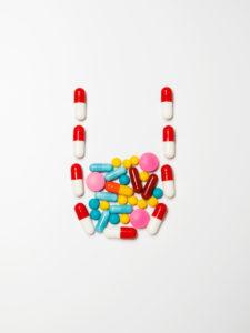Studio shot of arrangement of pills and capsules