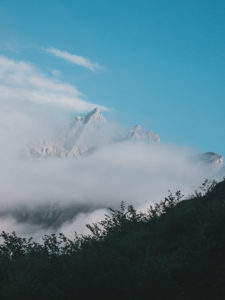 Spain, Cantabria, Clouds shrouding snowcapped peak in Picos de Europa