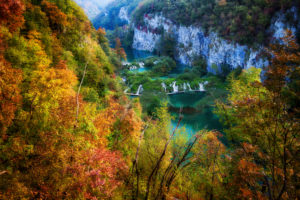 Croatia, Scenic view of lake surrounded by autumn forest in†Plitvice†Lakes National Park