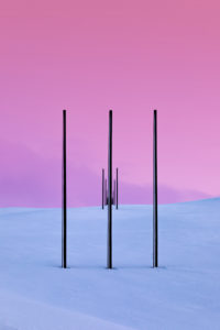 Power pylons in winter landscape, Tana, Norway