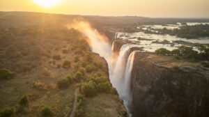 Scenic view of Victoria Falls against during sunset, Zimbabwe