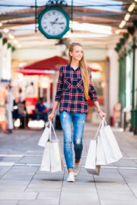 Portrait of happy young woman on a shopping spree