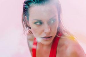 Portrait of beautiful woman wearing red swimsuit
