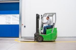 Man on forklift in a factory