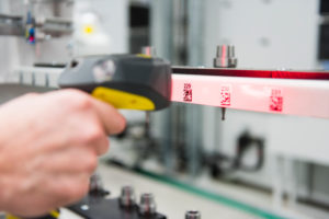 Close-up of man using barcode scanner in a factory