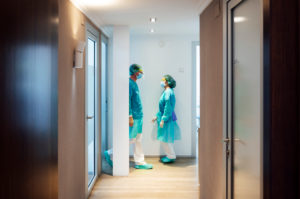 Male and female dentists walking in hallway at clinic