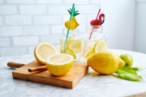 Cutting board, lemons and jars of fresh homemade lemonade