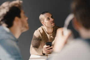 Young entrepreneur in a meeting using smartphone