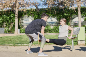 Woman during work out with coach in park