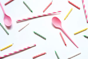 Studio shot of plastic spoons and birthday candles