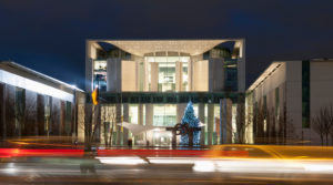 Germany, Berlin, View of chancellery with christmas tree at night