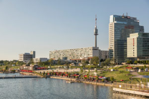 The leisure area CopaBeach on the Neue Donau, in the back buildings of the Danube City and the Danube Tower, 22nd district, Donaustadt, Vienna, Austria,