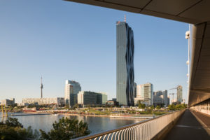 View from the Reichsbrücke to the leisure area CopaBeach on the New Danube, behind the buildings of the Danube City with the striking DC Tower 1, 22nd district, Donaustadt, Vienna, Austria,