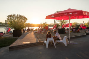The CopaBeach on the New Danube, view towards Danube Island and sunset, 22nd district, Donaustadt, Vienna, Austria,
