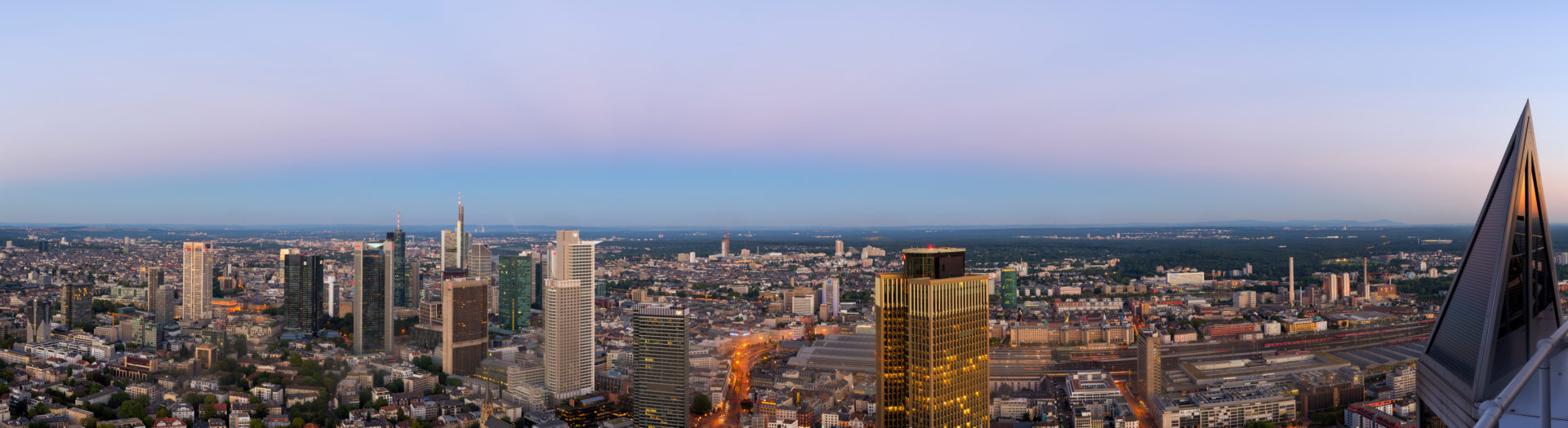 Frankfurt, Hessia, Germany, Panorama of the Frankfurt skyline with city centre and the financial district in the dusk.