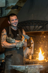 Pernes-les-Fontaines, Vaucluse, Provence-Alpes-Cote d'Azur, France. Blacksmith in the smithy La Forge