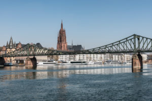 Frankfurt am Main, Hesse, Germany. Eiserner Steg with the old town and Frankfurt Cathedral.