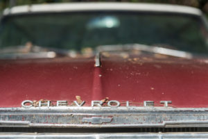 Wreckage of an old Chevrolet, detail.
