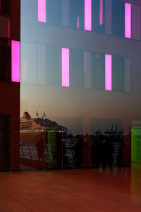 Reflection,cruise ship Queen Mary 2 departing at night with accompanying ships,Port of Hamburg,Germany,Europe
