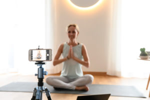 Yoga teacher, 40+ gives online yoga classes. Online video yoga class using a smartphone.