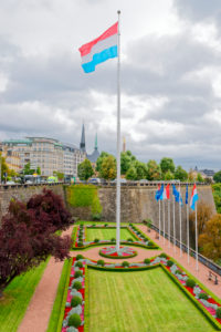 Luxembourg national flag in the park at the Place de la Constitution, Luxembourg City, Luxembourg,
