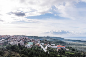 View of the city Gargaliani in Messenia, Greece, with clouds and sun