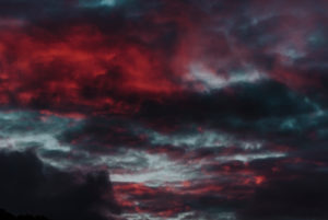 Red evening sun with clouds, blue red clouds