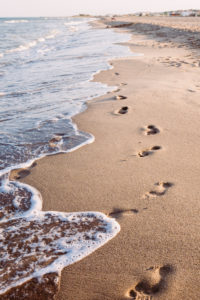 Tracks in the sand, footprints in the sand on the beach