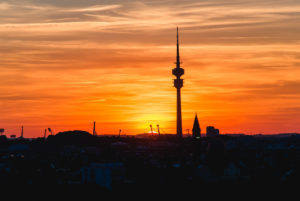Sunset over Munich and the silhouette of the Olympic Tower