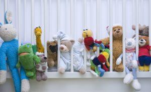 Crib, stuffed animals,