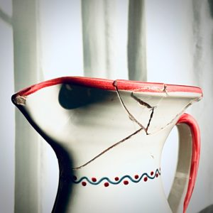 Broken jug glued and repaired