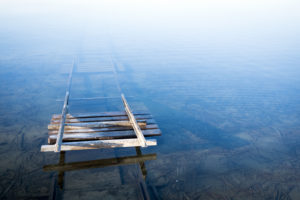 Rails sink into the cold lake