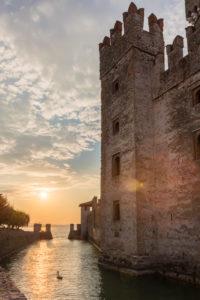 View to the Castello Scaligero after sunrise, Italy, Brescia, Lombardy, Lake Garda, Sirmione, sunrise