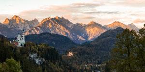 Neuschwanstein Castle in the morning, lighted Alps, mountain range, Germany, Bavaria, Allgäu, Ostallgäu,