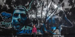 angry child in front of a graffiti, wolf, monkey, mural art, Spain, Europe, Santa Cruz, Tenerife
