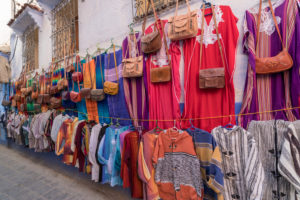 Sales booth in a blue alley in Chefchaouen, Morocco, North Africa, Africa