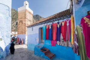 Mosque and sales stand in a blue alley of Chefchaouen, Morocco, North Africa, Africa