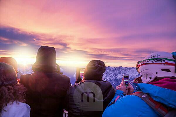 people at dawn on the panoramic terrace of punta rocca, marmolada, rocca pietore, belluno, veneto, italy