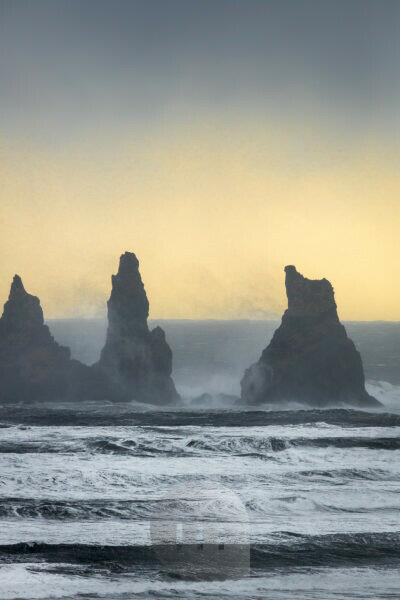 Basalt Sea Stacks and waves at Reynisfjara Beach located by Vik in Myrdal, South Coast of Iceland. Icelandic folklore states that these stacks are thought to be trolls.