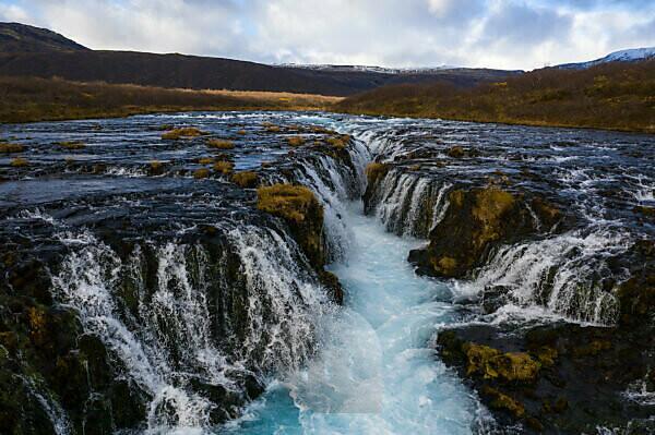 Iceland, waterfall in autumn, barren landscape