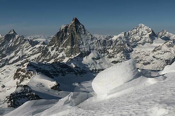 Switzerland, Valais, Zermatt, snowdrifts on the ridge of the Breithorn with Dent d'Herens, Matterhorn, Dent Blanche and Grand Cornier