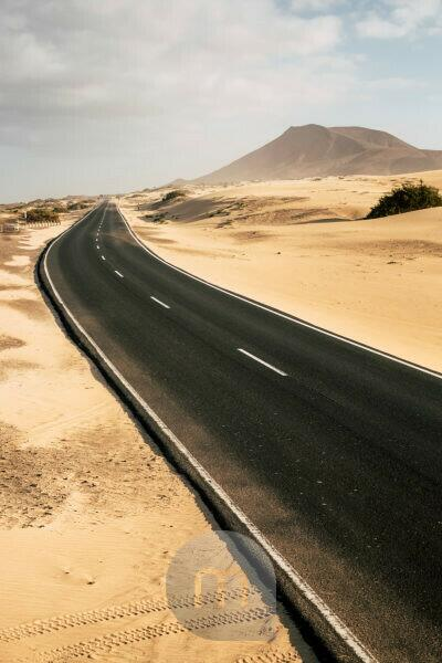 Travel and vehicle long black asphalt road with nature wild outdoor desert around - alternative journey with car and no traffic on highway - climate change or vacation place