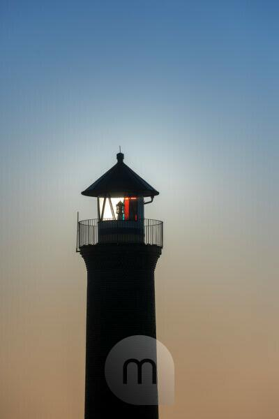 """Germany, Lower Saxony, East Frisia, Juist, """"Memmertfeuer"""" the lighthouse out of function at the port."""