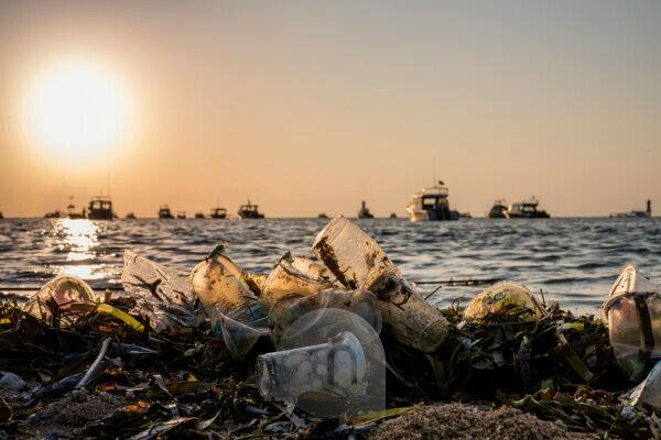 Washed-up plastic and plastic residues on the beach at sunrise, Pantai Sanur, Denpasar, Bali Island, Indonesia, Asia
