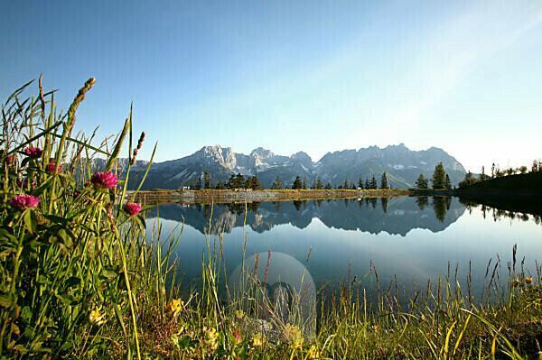 """der Astbergspeichersee bei Going in Tirol ist als """"Spiegel des Kaisers"""" bekannt"""