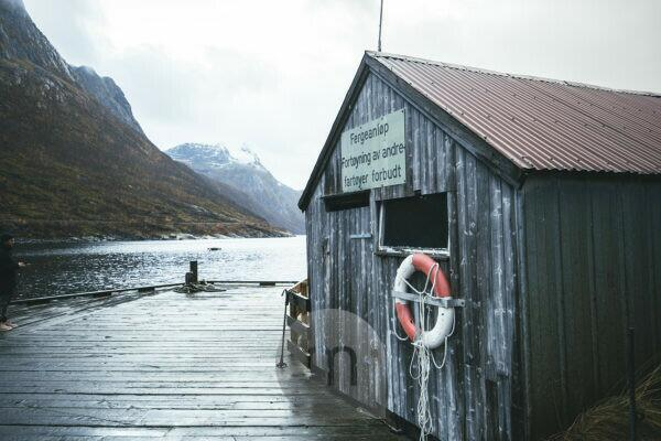 Old fishing hut in the fjords of Senja, Norway