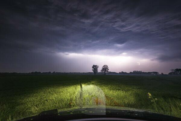 A thunderstorm over Wietmarschen near Nordhorn photographed from a car in a meadow
