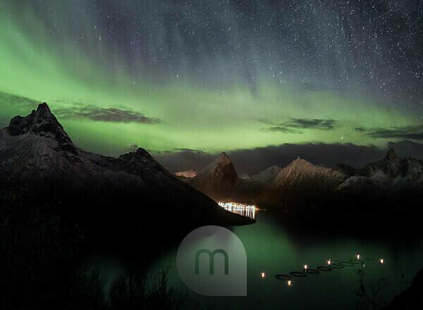Northern lights over Fjordgård on Senja Island in Norway at night