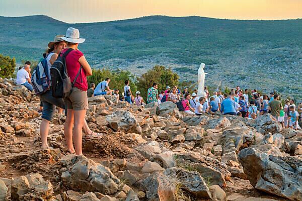 pilgrims on the hill of apparitions, Podbrdo, Medjugorje, municipality of Citluk, Bosnia and Herzegovina,