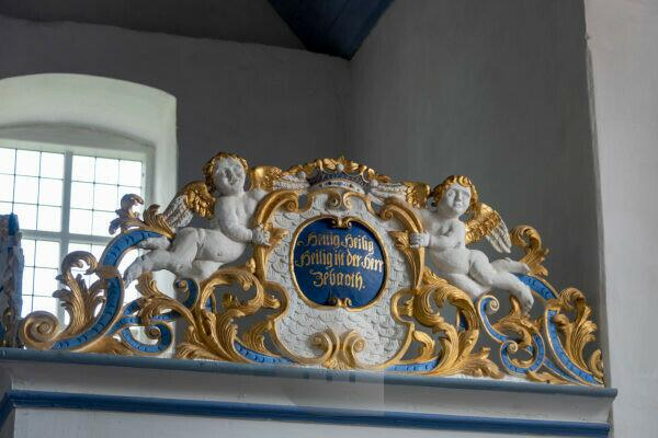 Germany, Mecklenburg-West Pomerania, Hiddensee, view of golden angels in the church in monastery. It is the last visible building from the time of the Cistercian monastery and thus the oldest building on the island of Hiddensee.